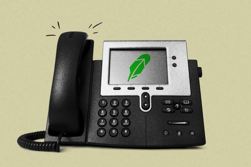 Office phone ringing with Robinhood logo on the digital screen